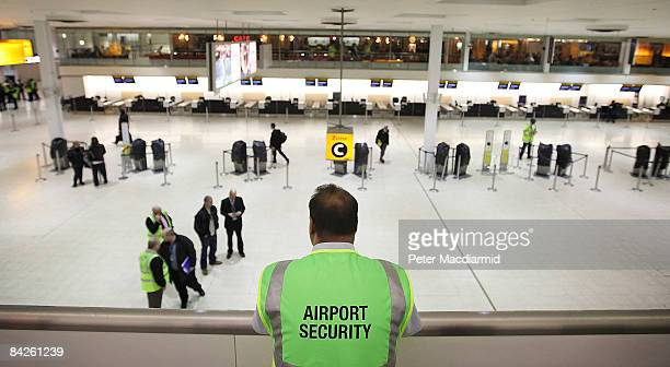 British Airports Authority security guard looks out over teminal 1 departures lounge at Heathrow Airport on January 12 2009 in London England
