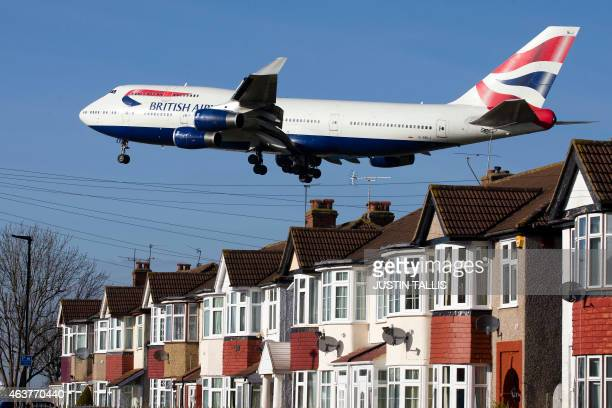 A British Airways 747 aircraft flies over roof tops as it comes into lane at Heathrow Airport in west London on February 18 2015 Heathrow's expansion...