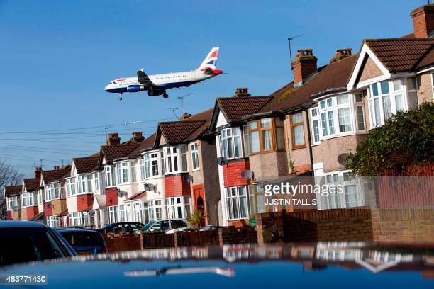 A British Airways aircraft flies over roof tops as it comes into lane at Heathrow Airport in west London on February 18 2015 Heathrow's expansion...