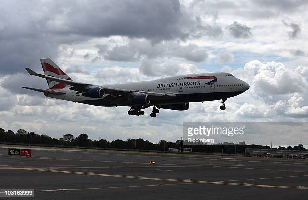 A British Airways aircraft lands at Heathrow airport in London UK on Thursday July 29 2010 British Airways Plc said its firstquarter loss widened...