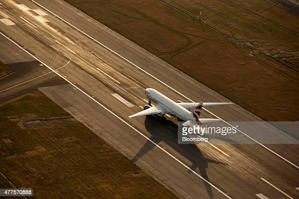 A British Airways aircraft operated by British Airways Plc prepares to takeoff from the north runway at London Heathrow Airport in this aerial...