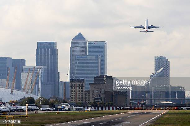 A British Airways aircraft operated by British Airways Plc takes off from London City Airport near to the Canary Wharf business financial and...
