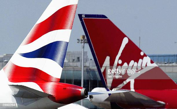 A British Airways aircraft taxis past it's rival carrier Virgin at Heathrow airport June 24 2003 in London EnglandBritish Airways is expected to...
