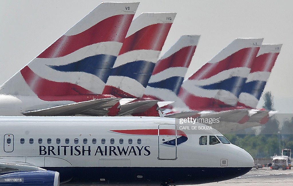 A British Airways aircraft taxis past other parked British Airways aircraft at Terminal 5 of Heathrow Airport in west London on May 21 2010 British...