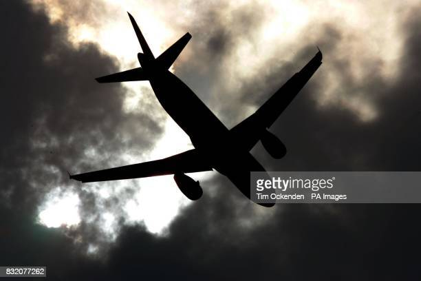 A British Airways aircratft takes off into stormey skies at London's Heathrow airport