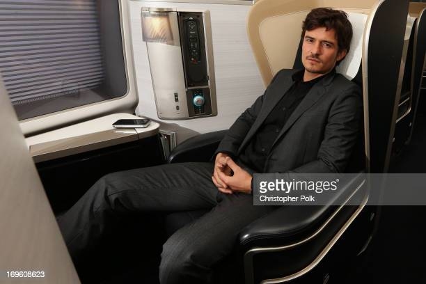 British Airways ambassador Orlando Bloom poses in a British Airways First Class Cabin to launch BA's new products on the Sydney to London route on...