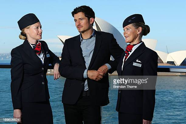 British Airways ambassador Orlando Bloom poses with British Airways cabin crew members at an exclusive event to launch BA's new products on the...