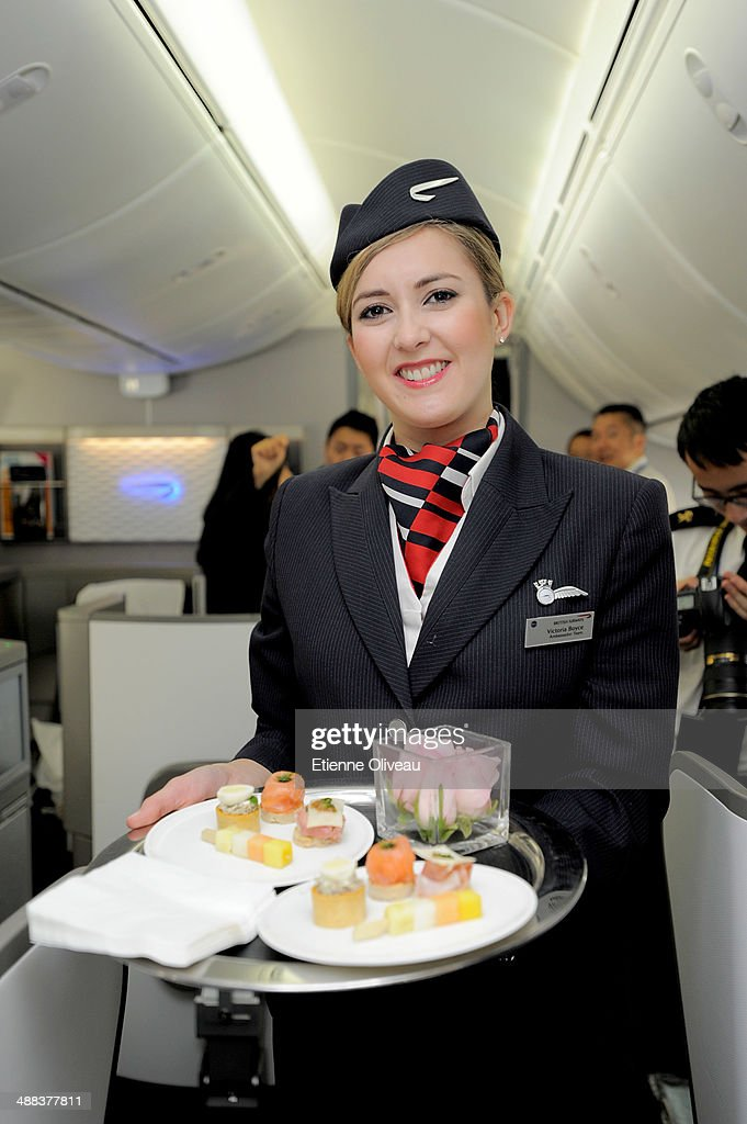 British Airways ambassador Victoria Massey serves guests onboard the airlines new Boeing 787 Dreamliner to Chengdu from London Heathrow on May 6 2014...