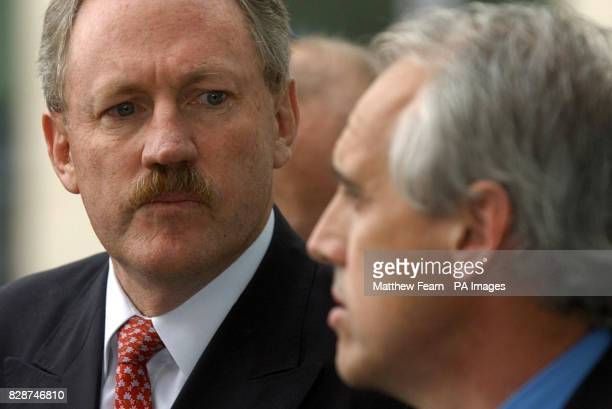 British Airways Chief Executive Rod Eddington listens as Kevin Curran boss of GMB trade union speaks to the media outside British Airways...