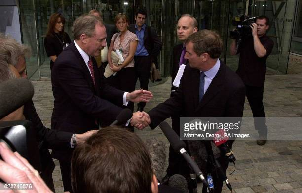 British Airways Chief Executive Rod Eddington shakes hands with Amicus trade union boss Paul Talbot after speaking to the media outside British...