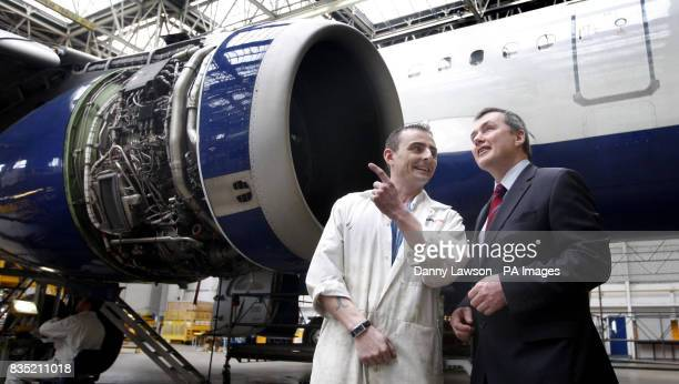 British Airways chief executive Willie Walsh speaks with BA mechanic Patrick Duffy during a visit to the a British Airways engineering hangar near...