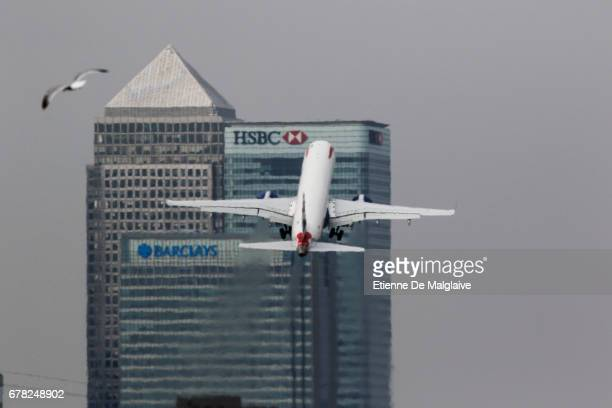 British Airways Embraer ERJ 190 takes off from the London City LCY airport and climbs over Canary Wharf financial district on April 20 2017 in London...