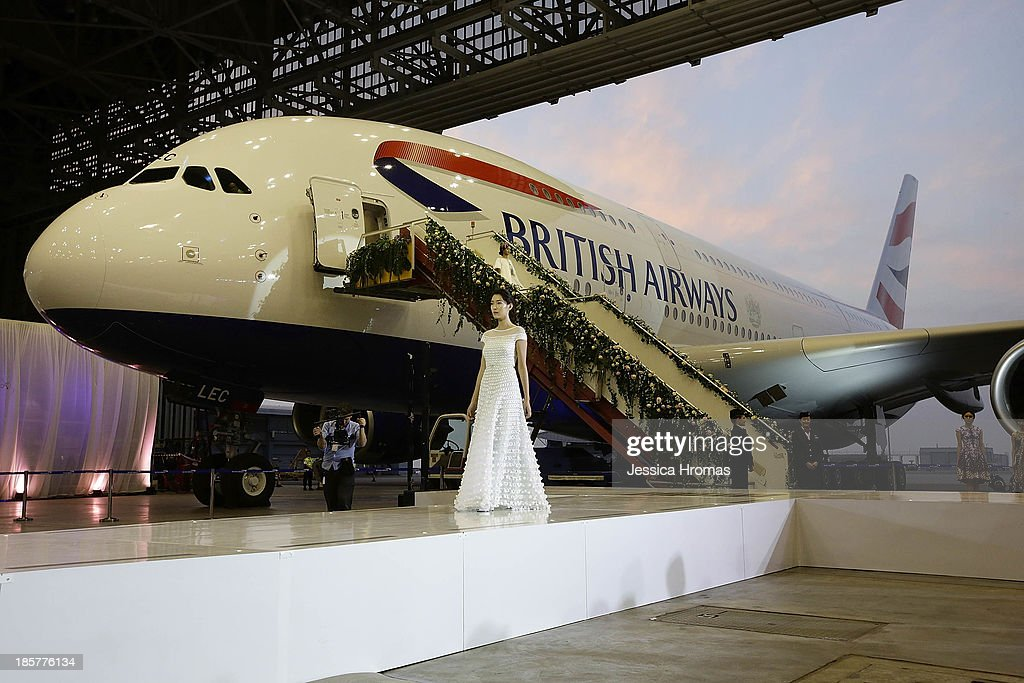British Airways 'Gig On A Wing' event launches with a fashion show by acclaimed British designer Alice Temperley MBE, Showing her Spring/Summer 2014 collection on October 24, 2013 in Hong Kong. Models desend the steps of the A380 aircraft onto British Airways specially created 'runway' catwalk.