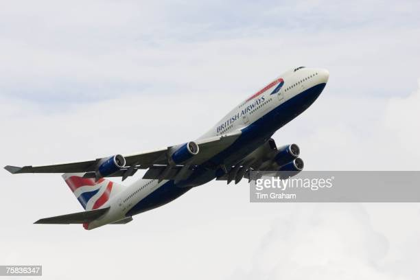 British Airways Jumbo Jet flying away from Heathrow London United Kingdom