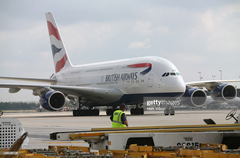 British Airways' new super jumbo Airbus A380 taxies up to its gate at Washington Dulles International Airport October 2 2014 in Dulles Virginia...