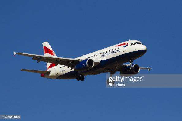 A British Airways passenger jet prepares to land at Madrid Barajas airport in Madrid Spain on Tuesday Aug 6 2013 British Airways parent IAG SA...
