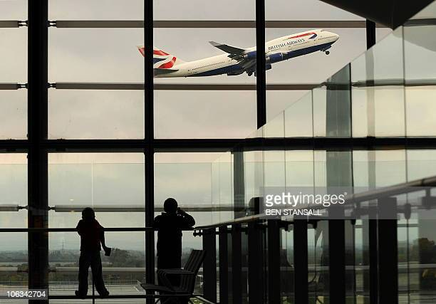A British Airways passenger jet takes off from Terminal 5 at Heathrow Airport west of London on October 29 2010 British Airways on Friday posted net...