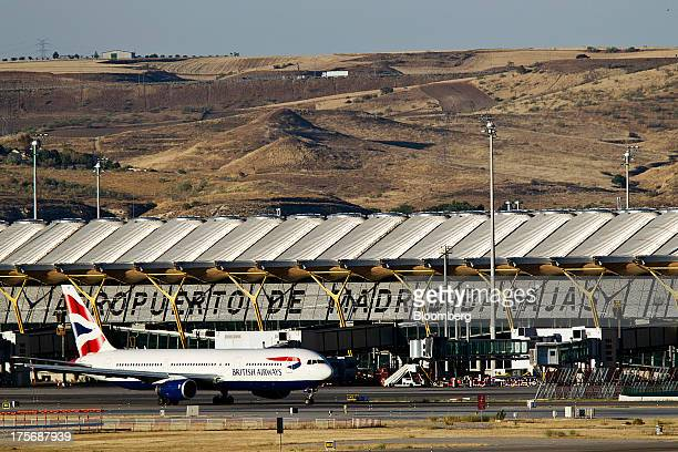 A British Airways passenger jet taxis along the tarmac at Madrid Barajas airport in Madrid Spain on Tuesday Aug 6 2013 British Airways parent IAG SA...