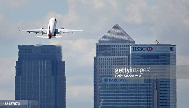 British Airways passenger plane takes off from from London City Airport in sight of Canary Wharf on August 6 2015 in London England US company Global...