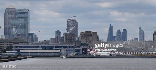 British Airways passenger planes line up at London City Airport in sight of Canary Wharf and the City on August 6 2015 in London England US company...