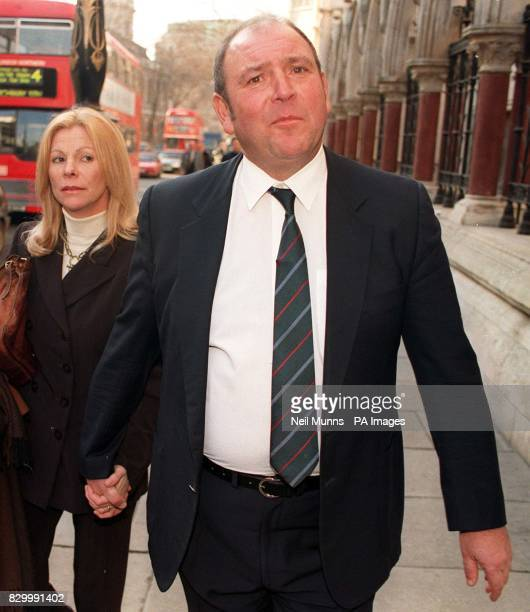 British Airways pilot Christopher Lankey with an unidentified woman outside the High Court this afternoon where he is seeking a declaration against...