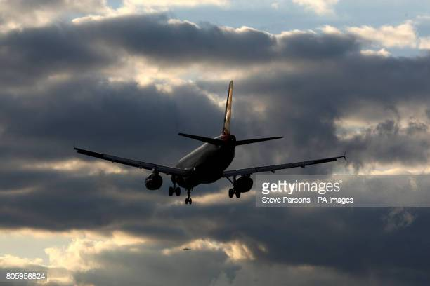A British Airways plane comes in to land at Heathrow Airport in Middlesex