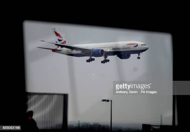A British Airways plane comes in to land at Heathrow's Terminal 5 as British Airways said it was considering a pay freeze for its 42000 staff after...
