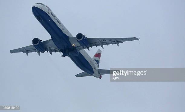A British airways plane flies away after taking off from Heathrow airport in west London on January 21 2013 after the airport announced further...