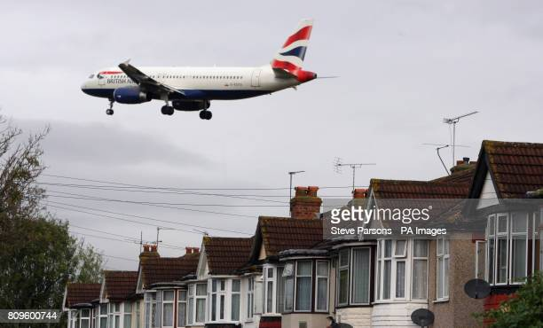 A British Airways plane flies over houses in Bedfont Middlesex as it comes into land on the Southern runway at London's Heathrow Airport