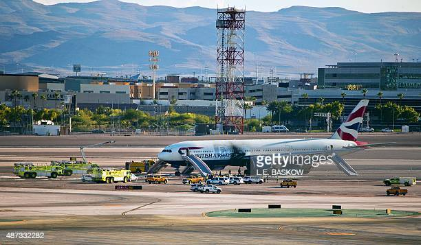 British Airways plane sits on a runway surrounded by emergency vehicles at McCarran International Airport following a fire onboard on September 8...