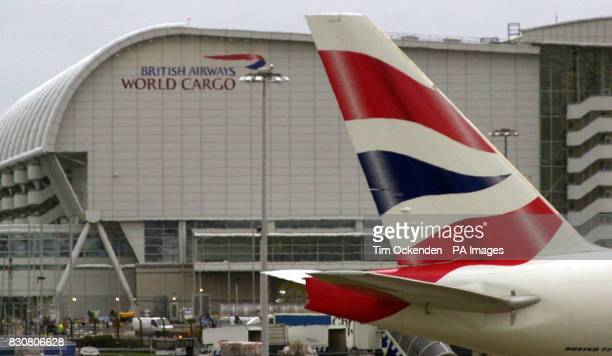 A British Airways plane stands in front of the airline's World Cargo centre at London's Heathrow Airport as police continued to hunt for robbers who...