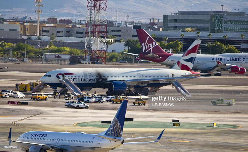 British Airways plane stands on runway surrounded by emergency vehicles at McCarran International Airport following a fire onboard on September 8...