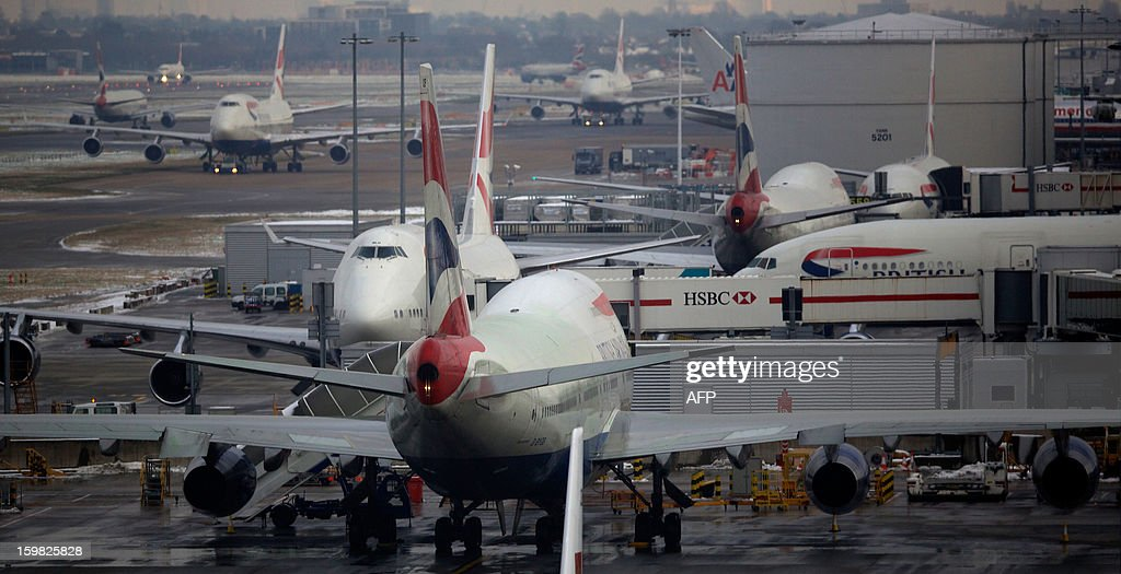 British airways planes are docked at Terminal 5 Heathrow airport in west London on January 21, 2013 after the airport announced further flight cancellations due to adverse weather. London's Heathrow Airport warned of further flight cancellations on January 21 which would leave thousands more passengers stranded on the fourth day of delays after heavy snow swept across Britain. AFP PHOTO/ANDREW COWIE
