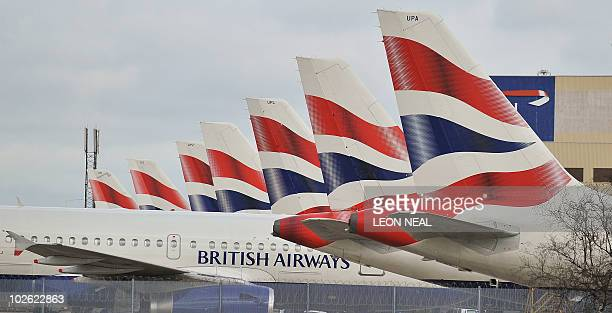 British Airways planes are grounded at Heathrow Airport on March 28 on the second day of a fourday strike bringing further travel disruption with no...