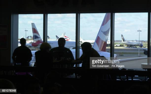 British Airways planes outside the window of Heathrow Airport's Terminal 4 in London