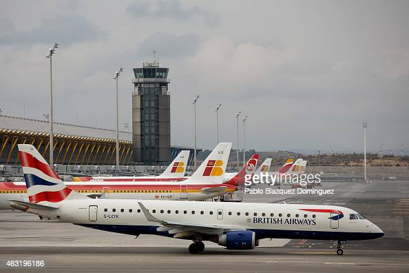 British Airways planes prepares to take off as other planes remain parked at Madrid Barajas Adolfo Suarez airport which is operated by group Aena on...