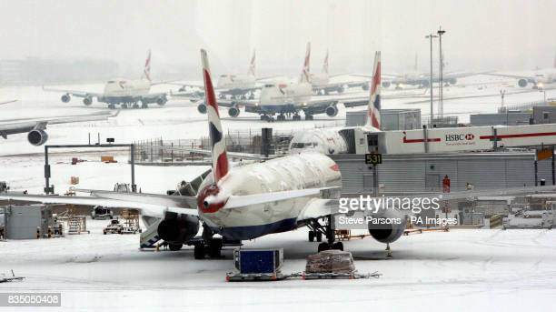 British Airways Planes wait in the snow outside Terminal 5 at Heathrow Airport after the snow closed both the runways for a short time and the planes...