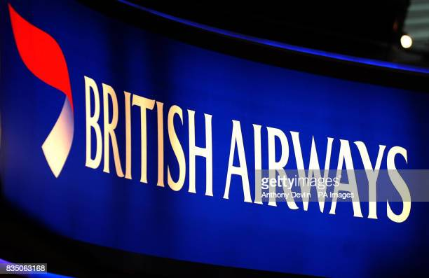 A British Airways sign at Heathrow's Terminal 5 as British Airways said it was considering a pay freeze for its 42000 staff after reporting a 70...