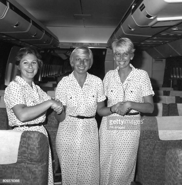 British Airways stewardesses Clare Carter Rita Ellis 33 of SunburyonThames and Fiona O'Shea 26 of Malvern pose on the plane after landing at Heathrow...
