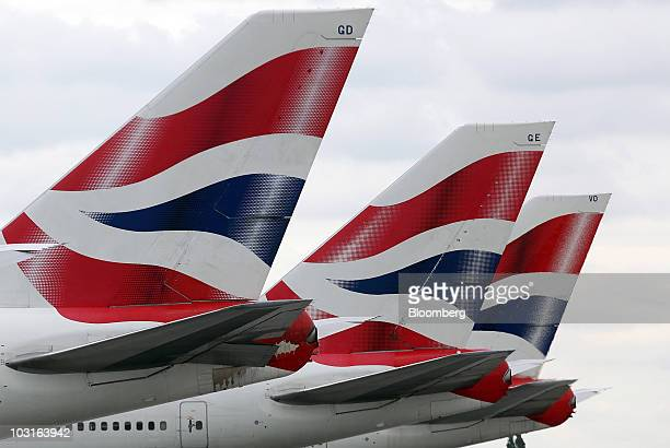 British Airways tail fins are seen at Heathrow airport in London UK on Thursday July 29 2010 British Airways Plc said its firstquarter loss widened...