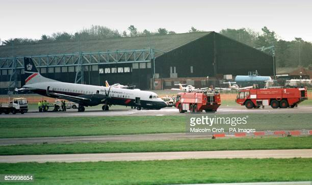 A British Airways twinengined ATP aircraft lies on the runway at Manchester Airport today after the nosewheel collapsed on landing Fiftyeight...