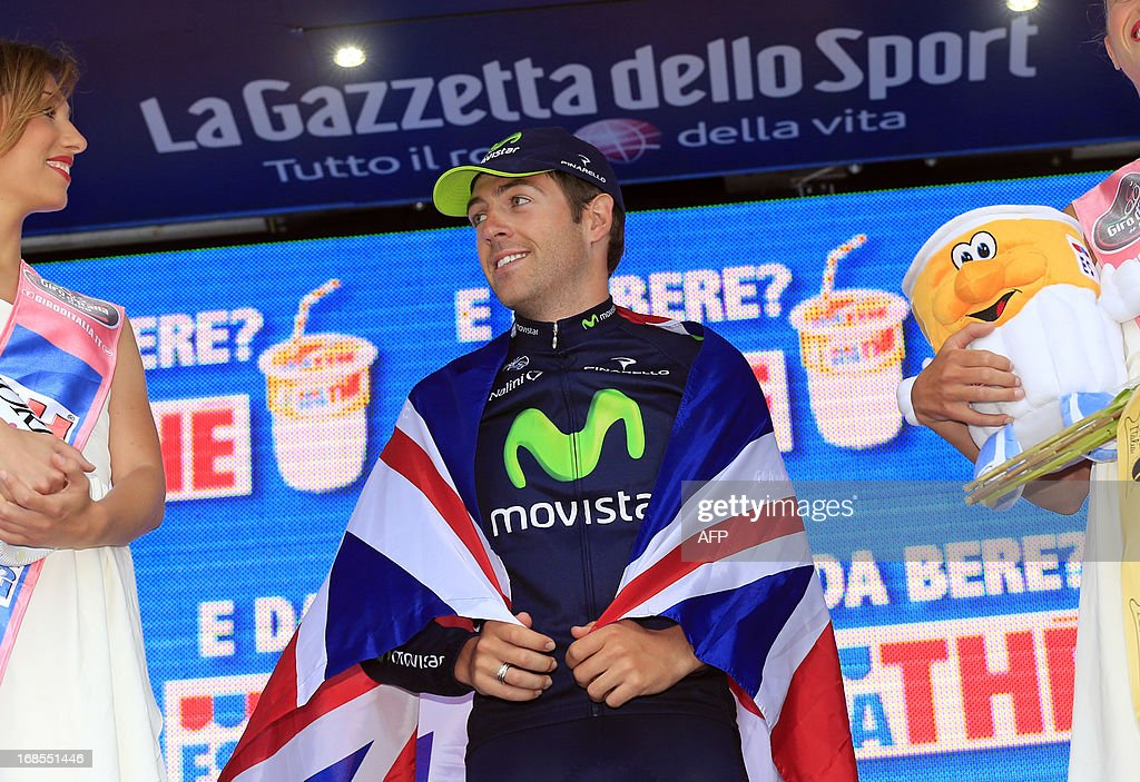 British Alex Dowsett celebrates on the podium winning the 55,5kms eigth stage of the 96th Giro d'Italia time trial from Gabicce Mare to Saltara on May 11, 2013 in Saltara, Italy.Briton Alex Dowsett took the honours ahead of compatriot Bradley Wiggins in the Tour of Italy's eighth stage time trial on Saturday with Italian Vincenzo Nibali inheriting the leader's pink jersey. AFP PHOTO / LUK BENIES