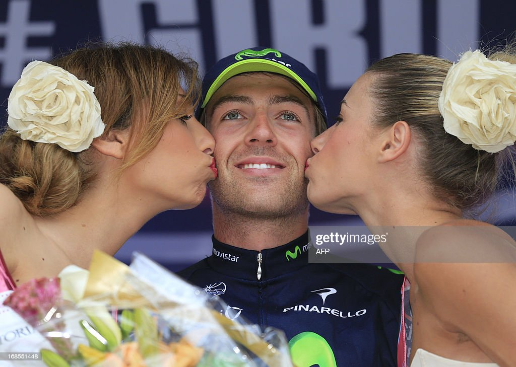 British Alex Dowsett celebrates on the podium winning the 55,5kms eigth stage of the 96th Giro d'Italia time trial from Gabicce Mare to Saltara on May 11, 2013 in Saltara, Italy.Briton Alex Dowsett took the honours ahead of compatriot Bradley Wiggins in the Tour of Italy's eighth stage time trial on Saturday with Italian Vincenzo Nibali inheriting the leader's pink jersey.