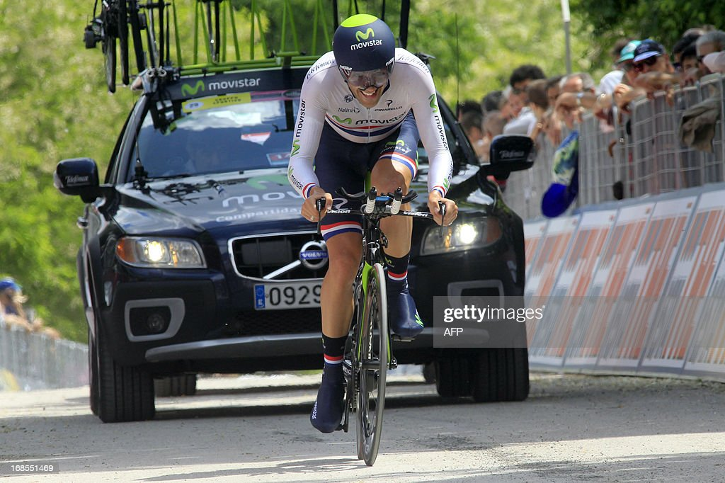 British Alex Dowsett rides to win the 55,5kms eigth stage of the 96th Giro d'Italia time trial from Gabicce Mare to Saltara on May 11, 2013 in Saltara, Italy.Briton Alex Dowsett took the honours ahead of compatriot Bradley Wiggins in the Tour of Italy's eighth stage time trial on Saturday with Italian Vincenzo Nibali inheriting the leader's pink jersey. AFP PHOTO / LUK BENIES