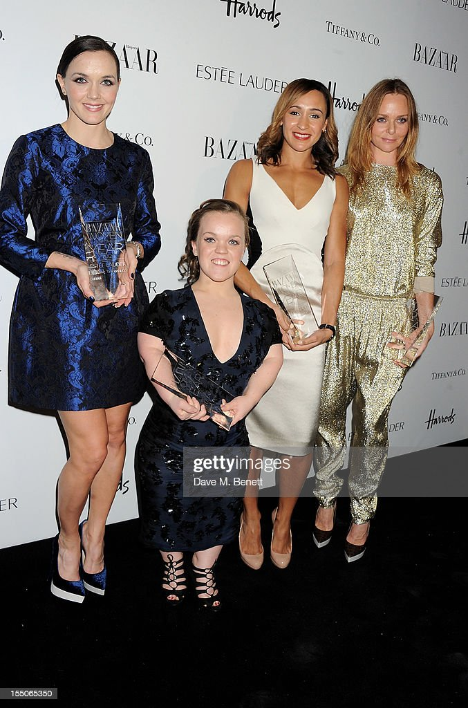 British Ambassadors of the Year co-winners <a gi-track='captionPersonalityLinkClicked' href=/galleries/search?phrase=Victoria+Pendleton&family=editorial&specificpeople=228525 ng-click='$event.stopPropagation()'>Victoria Pendleton</a>, Ellie Simmonds and <a gi-track='captionPersonalityLinkClicked' href=/galleries/search?phrase=Jessica+Ennis&family=editorial&specificpeople=602482 ng-click='$event.stopPropagation()'>Jessica Ennis</a> pose with British Designer of the Year winner Stella McCartney at the Harper's Bazaar Women of the Year Awards 2012, in association with Estee Lauder, Harrods and Tiffany & Co., at Claridge's Hotel on October 31, 2012 in London, England.