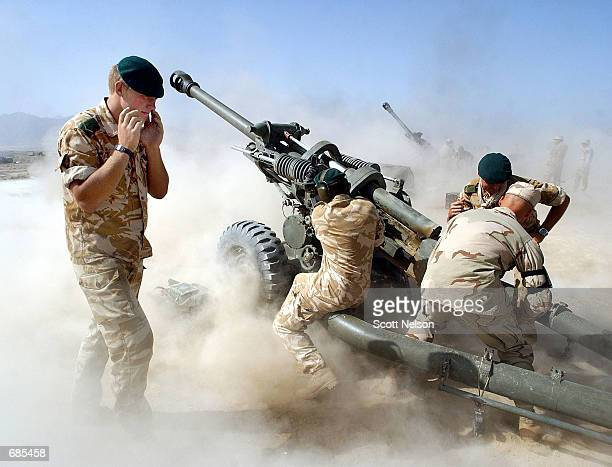 British and American forces fire 105mm artillery rounds during a live fire exercise June 11 2002 at Bagram Airbase in Afghanistan Coalition troops...
