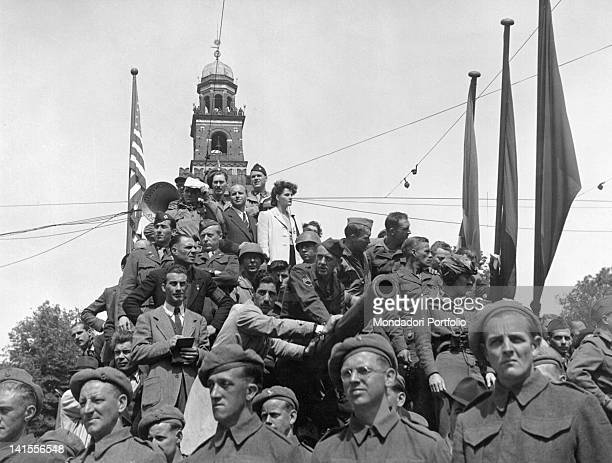 British and American soldiers standing on a tank in Piazza Castello in Milan during a partisan event celebrating the Liberation Milan 6th May 1945
