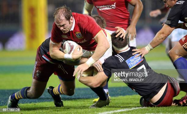 British and Irish Lions' Alun Wyn Jones is tackled during the rugby match between New Zealand's Provincial Barbarians and the British and Irish Lions...