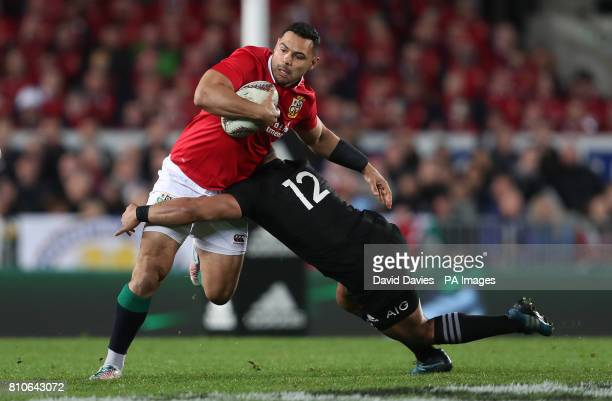 British and Irish Lions' Ben Te'o is tackled by New Zealand's Ngani Laumape during the third test of the 2017 British and Irish Lions tour at Eden...