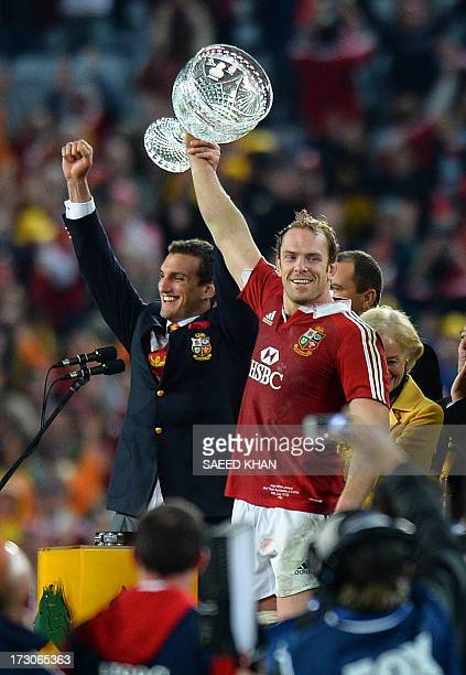 British and Irish Lions captain Alun Wyn Jones and Sam Warburton lift the winner's trophy after defeating Australia in the deciding rugby union test...